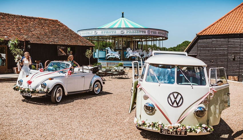The carousel and barns at Preston Court, Kent wedding venue