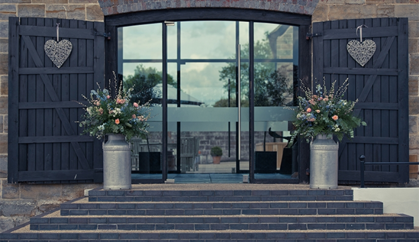 The beautiful front glassed entrance into Hendall Manor Barns, a Sussex wedding venue