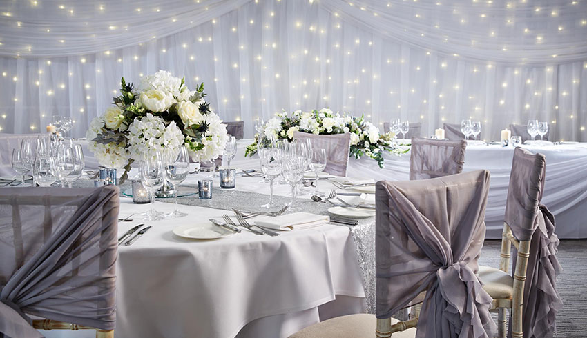 A close up of a beautiful grey themed wedding at the Alexander House Hotel, West Sussex