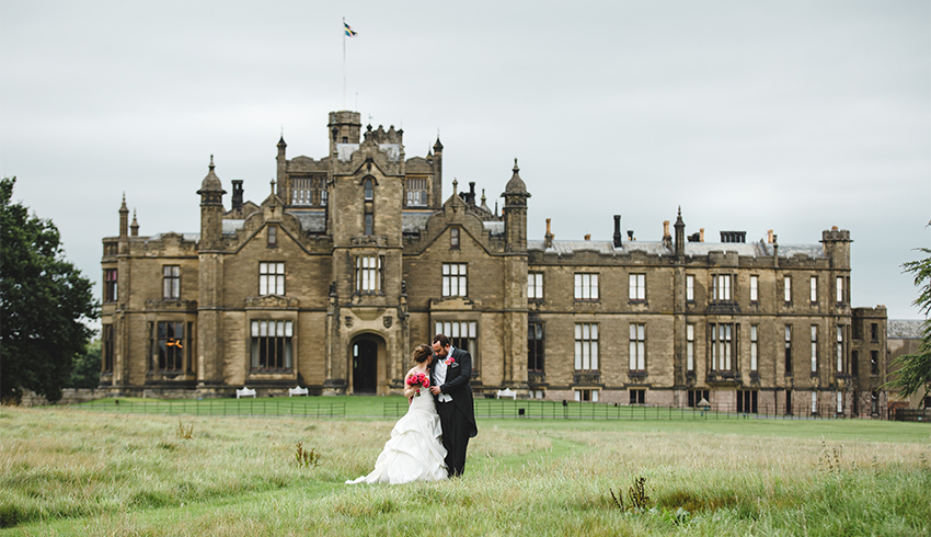 Wedding couple outside the front of Allerton Castle