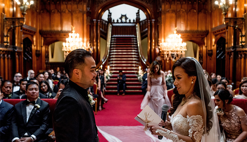 Wedding couple exchanging vows inside Allerton Castle