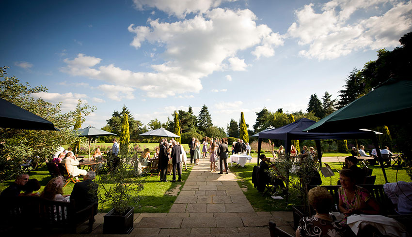 A wedding drinks reception in the grounds of Barnett Hill Hotel