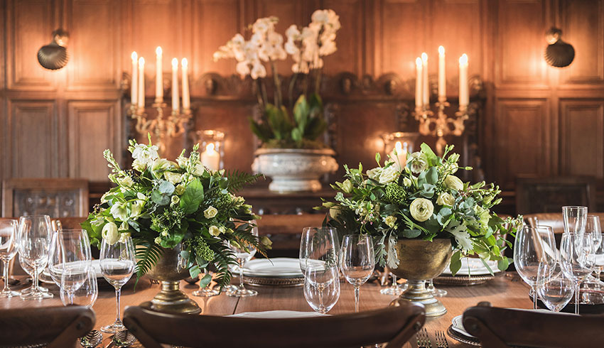 The oak-panelled dining room set up for a wedding breakfast