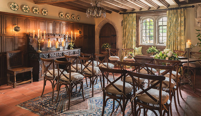 The oak-panelled dining room set up for a wedding ceremony