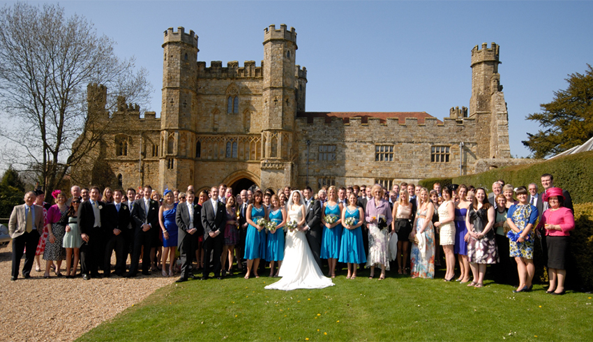 Wedding party group photograph outside Battle Abbey