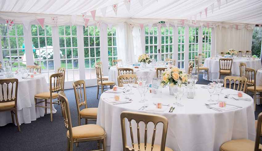 Inside the marquee at Broyle Place, an East Sussex wedding venue