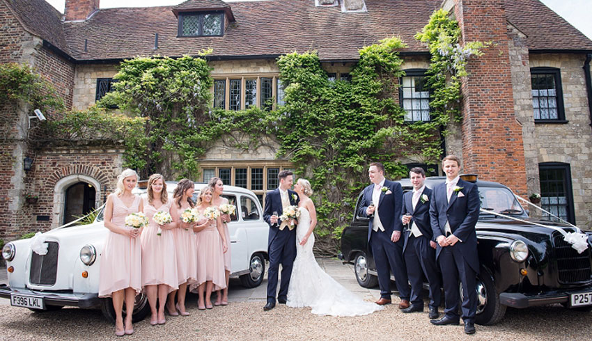 A wedding party arriving outside Broyle Place, a Sussex wedding venue
