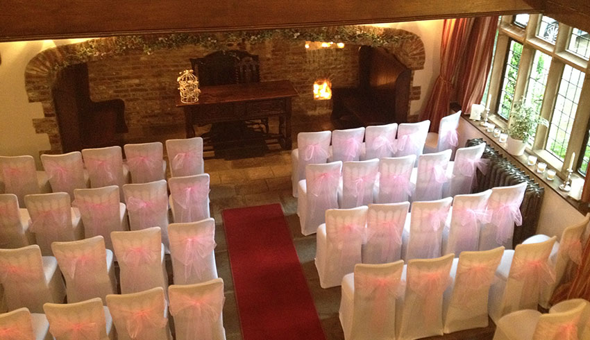 The Great Hall at Broyle Place set up for a wedding ceremony