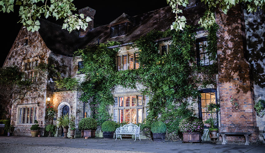 Outside Broyle Place at night, a wedding venue in Sussex