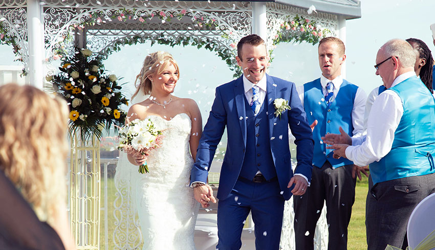 Wedding couple just married at the Cooden Beach Hotel