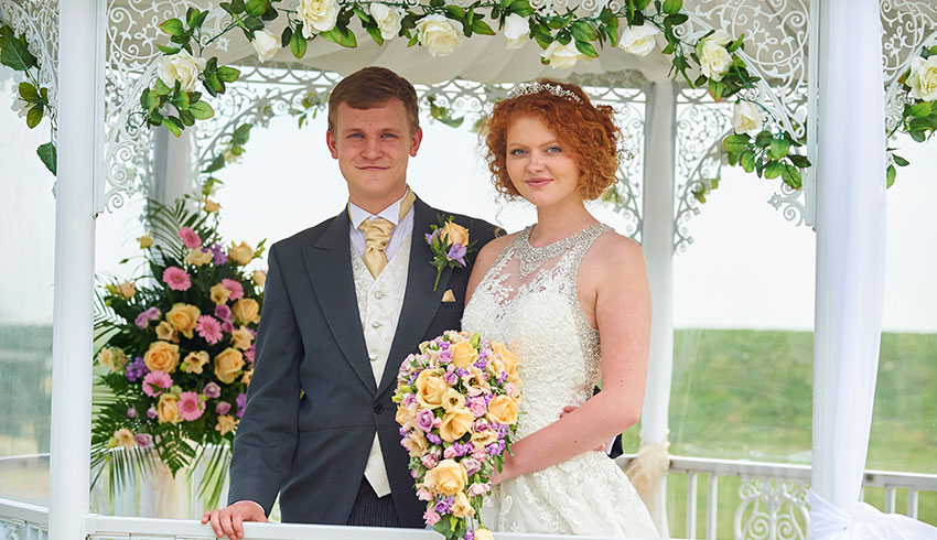 Wedding couple outside the Cooden Beach Hotel after their wedding