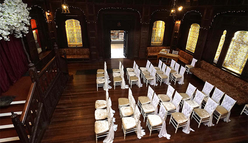 The historic Durbar Hall, a wedding venue in East Sussex set up for a wedding ceremony