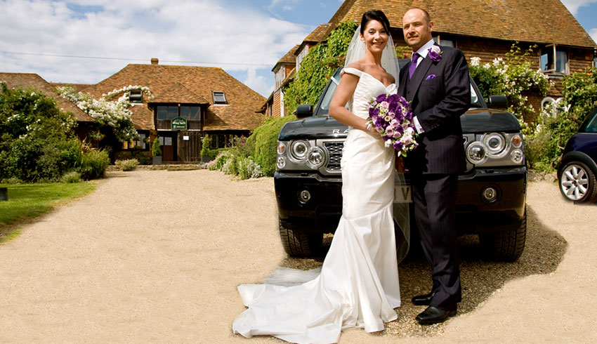 Bride and Groom outside the beautiful Elvey Farm wedding venue in Kent