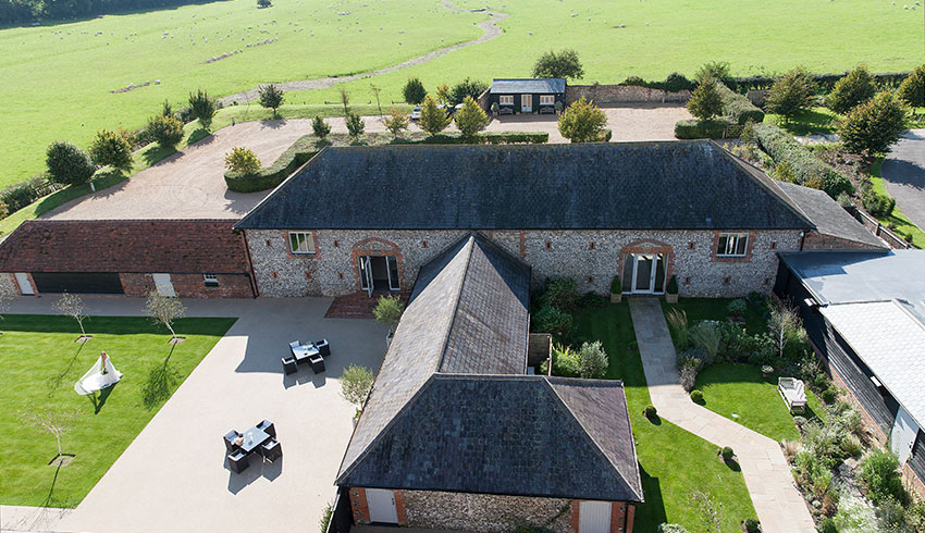 An aerial view of Farbridge wedding barn in West Sussex
