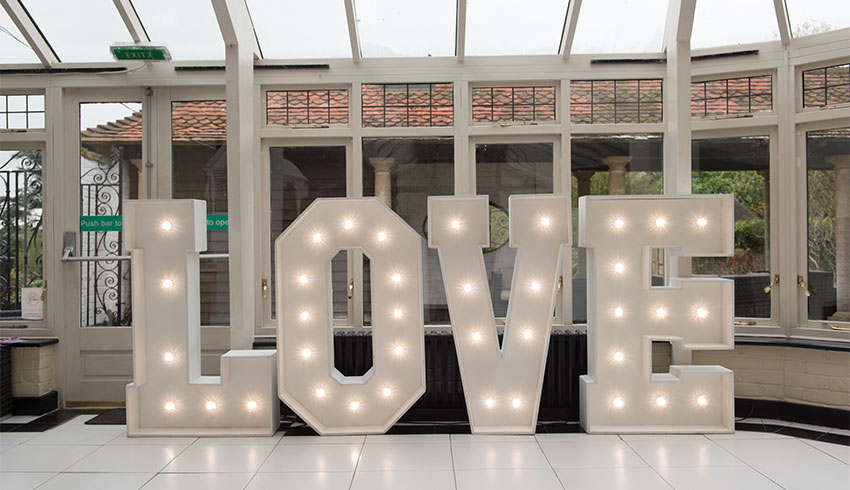 Love signage in the Conservatory at Ghyll Manor