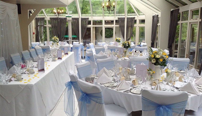 The conservatory at Ghyll Manor set up for a wedding reception