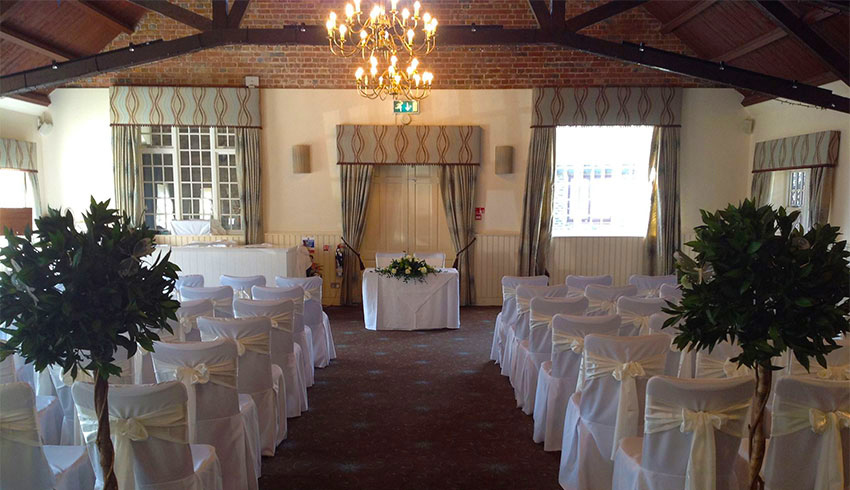 The Hudson Hall at Ghyll Manor set up for a wedding ceremony