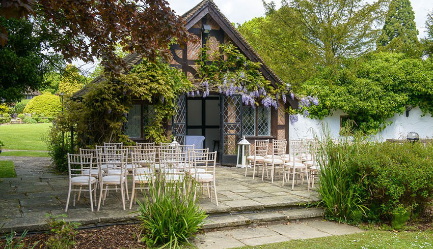 The Summer House at Ghyll Manor, set up as an outdoor wedding ceremony venue space