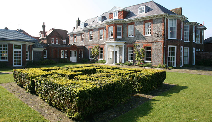 View of the outside of the beautiful Gildredge Manor, a Georgian wedding venue in East Sussex