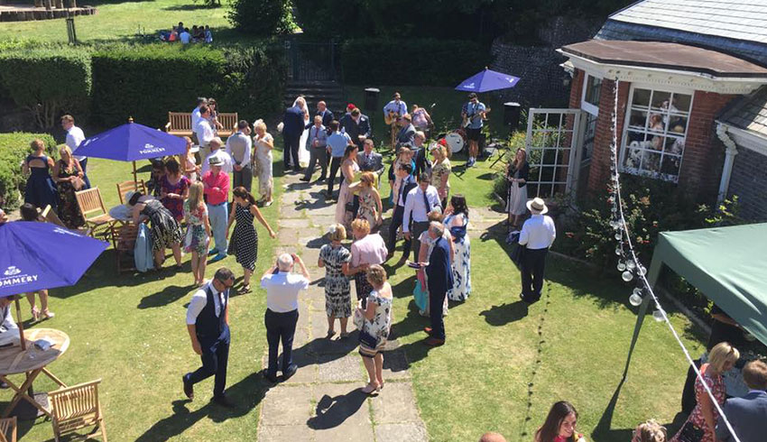 Wedding party enjoying the gardens at Gildredge Manor