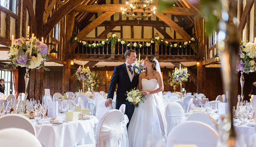 Bride and Groom in the Tithe Barn at Great Fosters