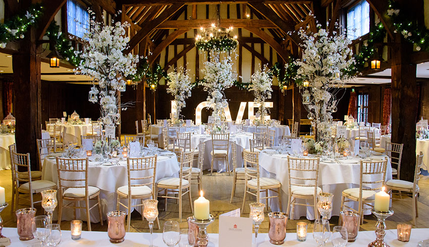 Great Fosters Tithe Barn set up for a beautiful wedding reception