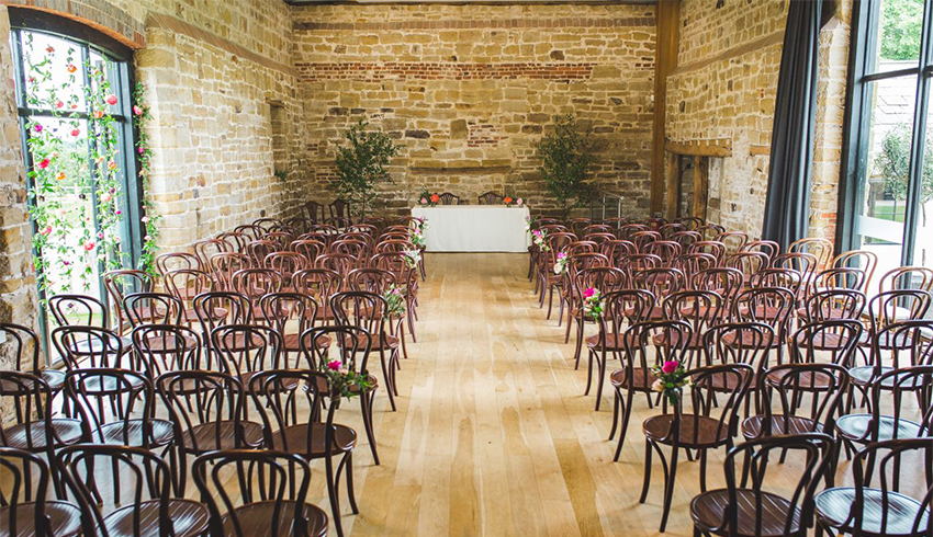 A stunning wedding ceremony set up at Hendall Manor Barn, East Sussex wedding venue