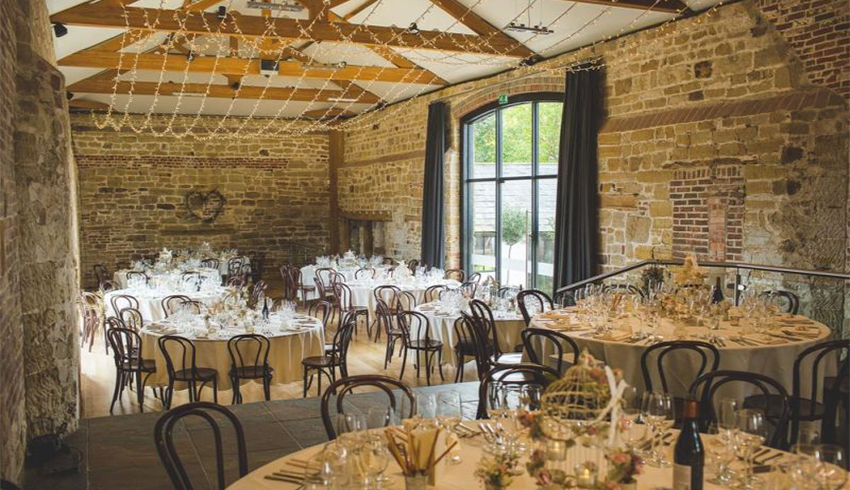A pretty wedding reception layout at Hendall Manor Barns