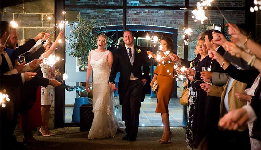Wedding sparklers at night at Hendall Manor Barns