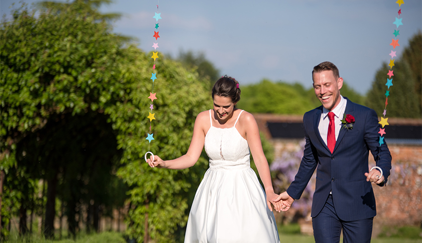 Wedding couple just married at the Highden Estate a wedding venue in West Sussex