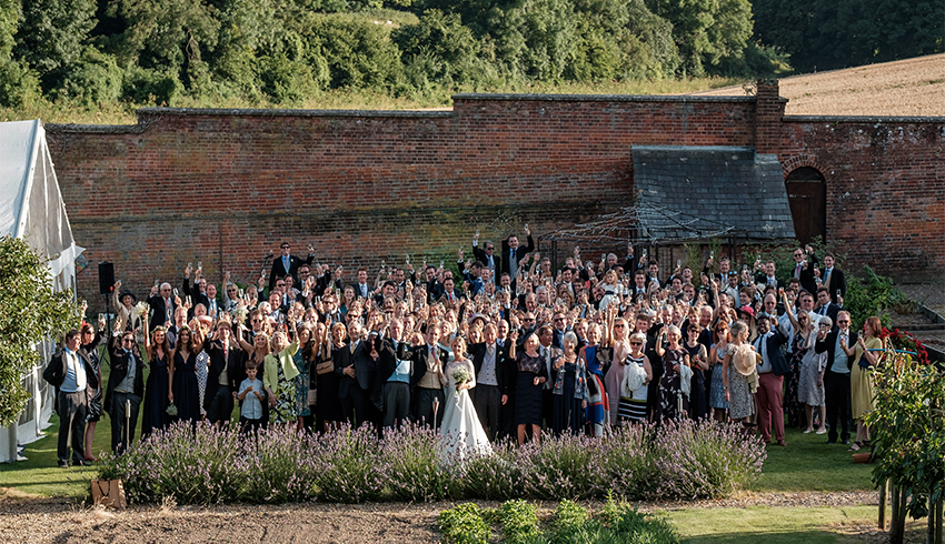 A group wedding picture taken within the Walled Garden at the stunning Highden Estate wedding venue