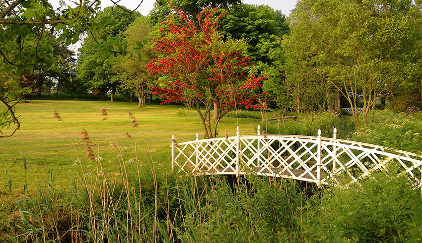 Bridge within the grounds of Milwards House, Sussex wedding venue