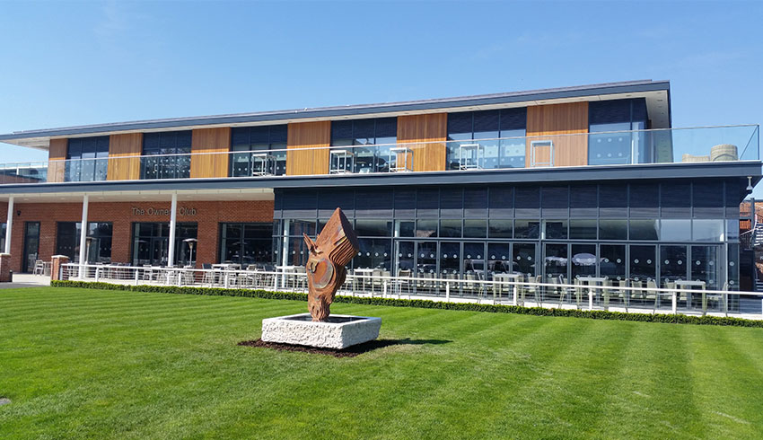 Outside the Owners Club at Newbury Racecourse, a Berkshire wedding venue