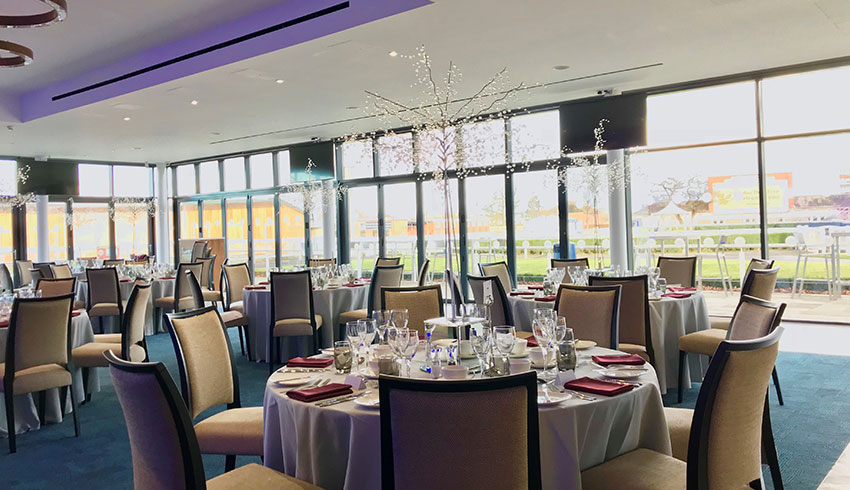 The Owners Club at Newbury Racecourse set up for an evening wedding reception