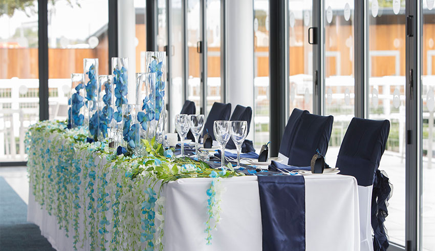 The top table set up for a wedding at Newbury Racecourse