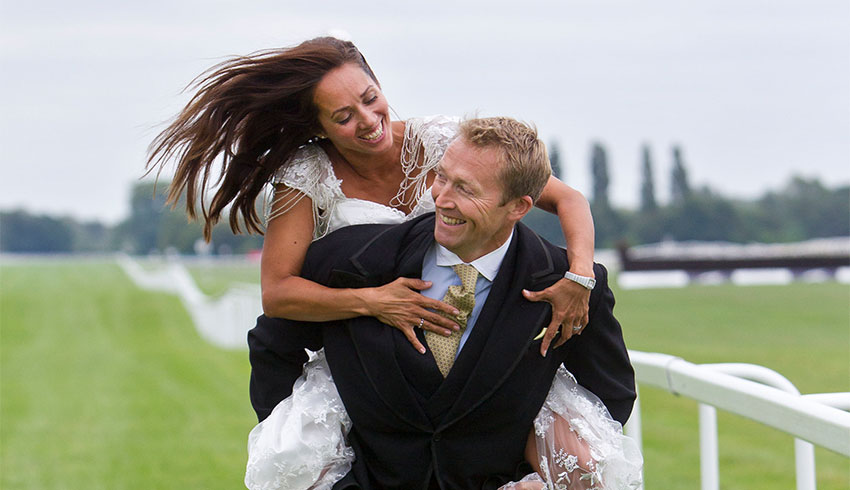 Bride and Groom enjoying the racecourse after their wedding at Newbury