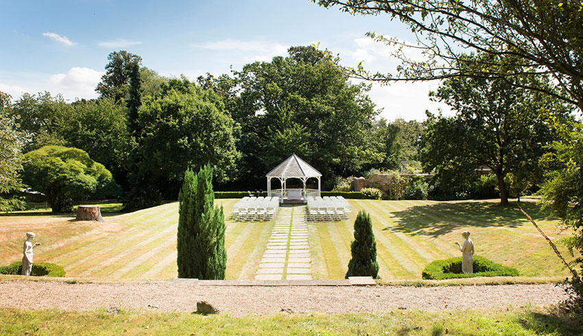 The outdoor wedding ceremony space at Rowhill Grange, a Kent wedding venue