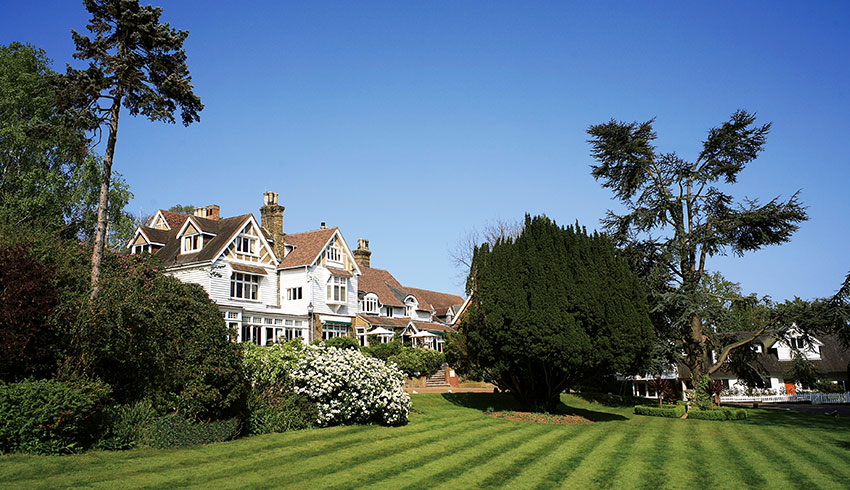 A view looking across the beautiful gardens of the outside of Rowhill Grange, a Kent wedding venue