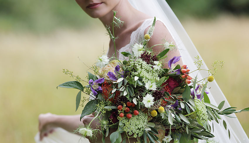 Bride and her wedding bouquet at the Runnymede Hotel