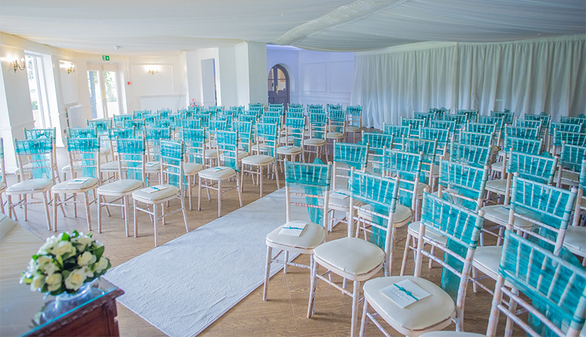 A blue themed wedding ceremony in Southdowns Manor