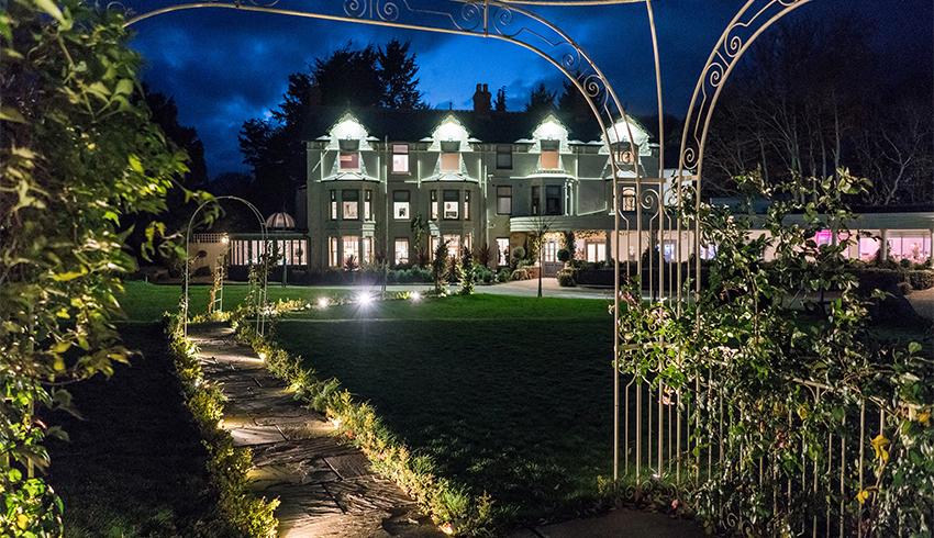 Southdowns Manor, a West Sussex wedding venue, lit up at night