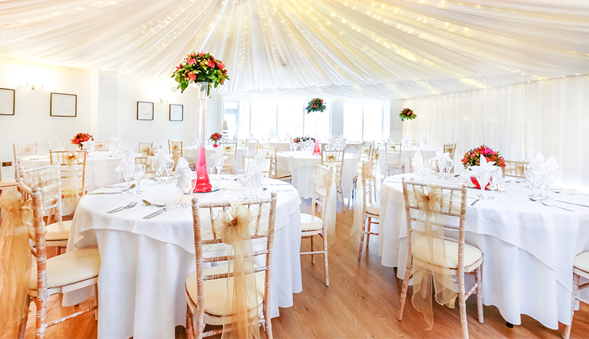 The elegant wedding reception room set up for a wedding at Southdowns Manor