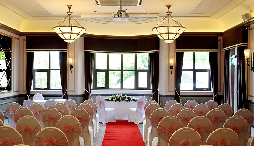 The Hogs Back Hotel, Surrey, showcases a grand wedding ceremony room