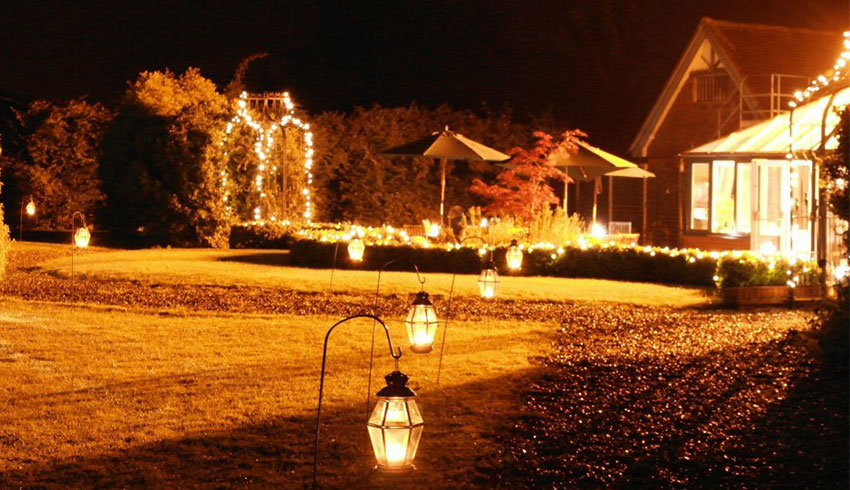 The gardens at night at the Parrot Inn, a Surrey Wedding Venue