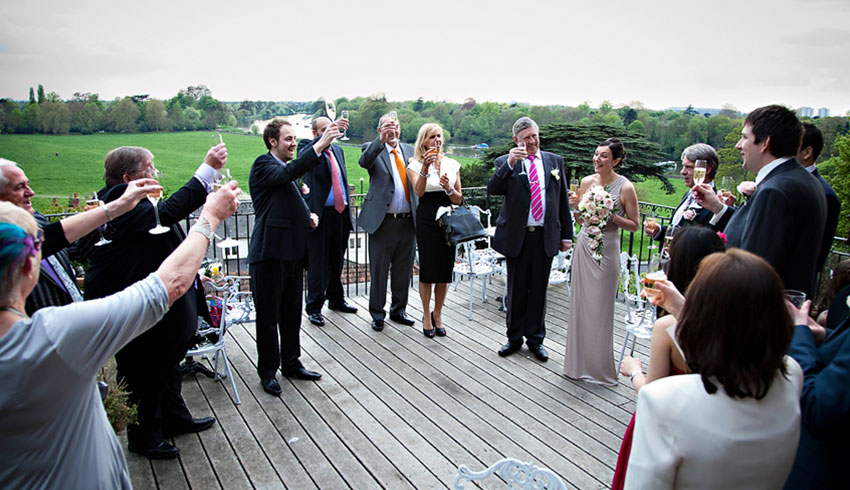 Wedding celebration on the terrace at the Petersham Hotel, a Surrey wedding venue