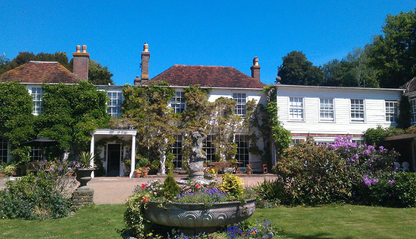 View of the outside of the PowderMills Hotel, East Sussex wedding venue