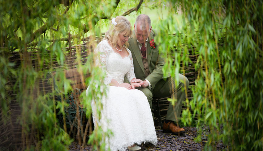Wedding couple taking a quiet moment together after their wedding at The Lost Village of Dode