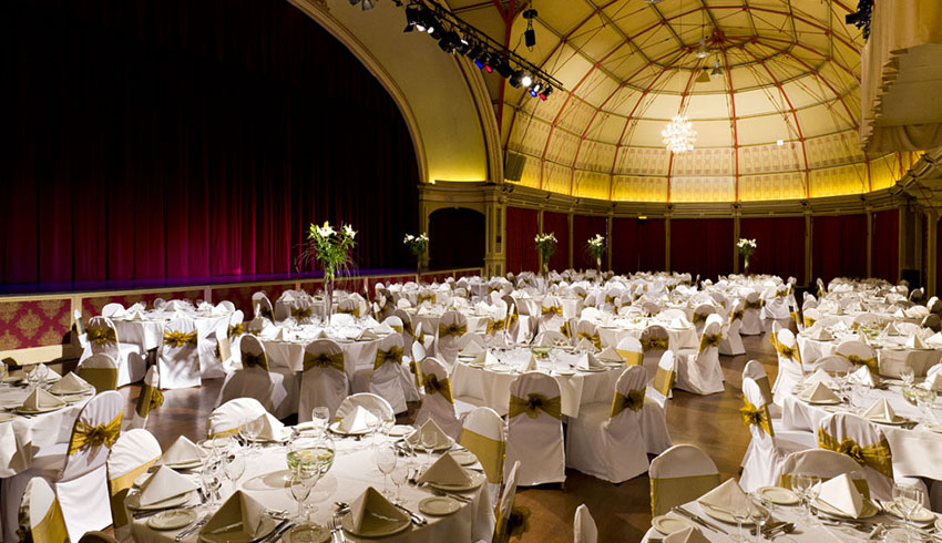 The Winter Gardens in Eastbourne set up for a wedding with its impressive historic interior