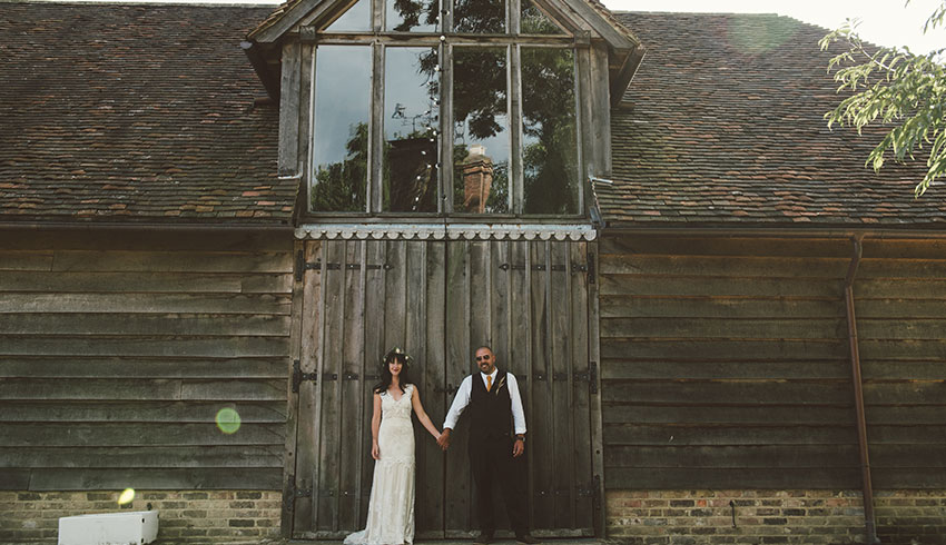 Wedding couple standing outside the barn at the Yoghurt Rooms